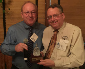 January 6, Tampa, Fla. -- Industry Council for Tangible Assets board member Barry Stuppler (left) presents Patrick A. Heller with the organization's inaugural Diane Piret Memorial Outstanding Service Award at the organization's board of directors meeting.