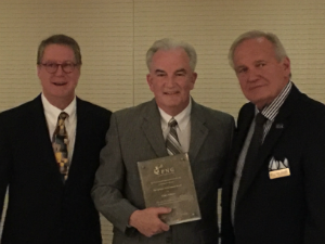 Pictured from left, Dana Samuelson (PNG president), Gary Adkins, and Bob Brueggeman (Executive Director)